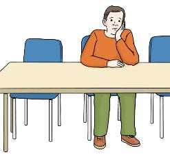 Mann sitzt einsam und traurig am Tisch